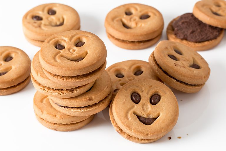 Pile of smiley sandwich cookies.