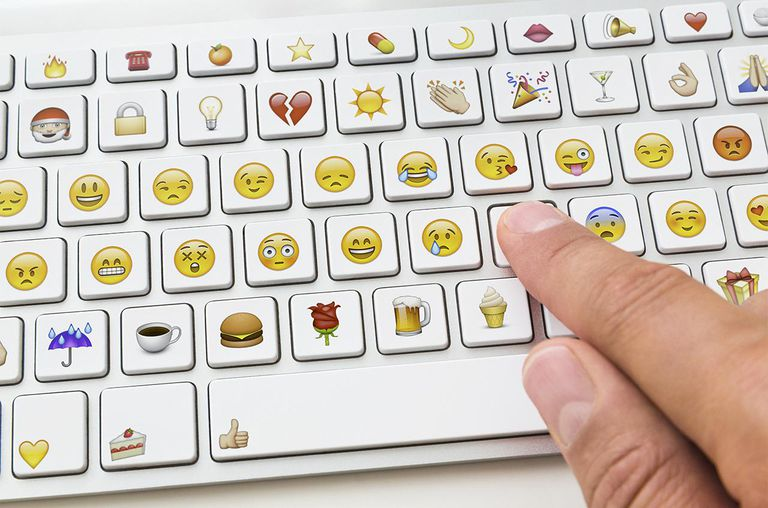 Hand using emoticon keyboard