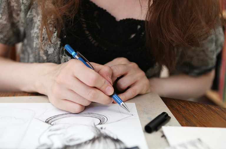 An illustrator working on an illustration
