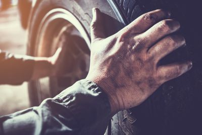 Dirty hands work on a tire