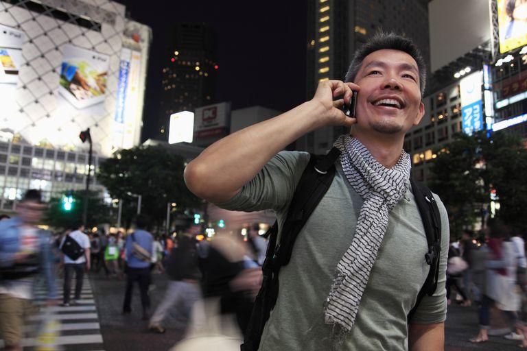 Man using smartphone in city