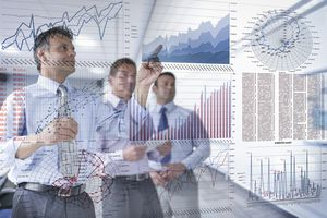 Businessmen discussing graphs and charts seen through screen