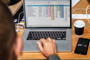 A laptop running a spreadsheet program.