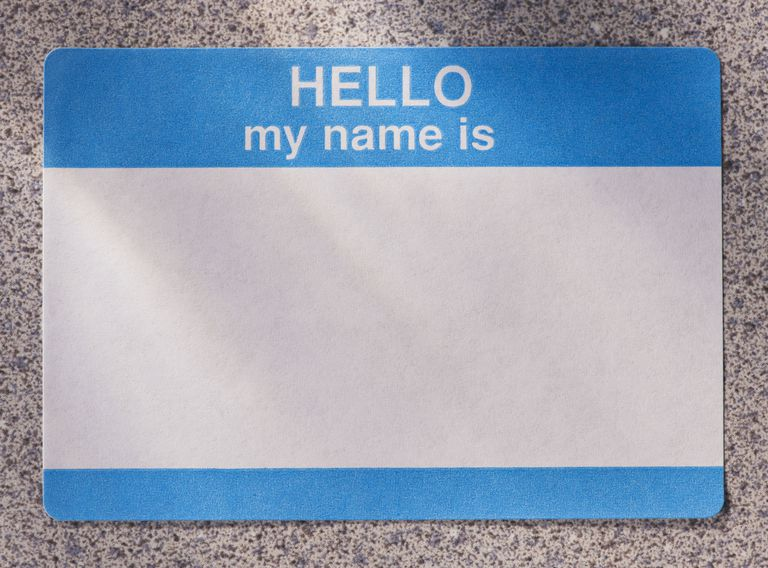 Close up of blank name tag that reads HELLO my name is