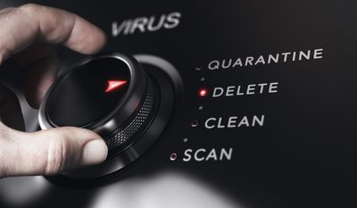Someone turning a dial on virus controls to delete.