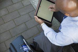 Man using calendar on tablet