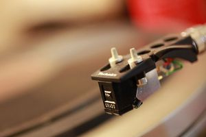 A turntable cartridge near a spinning record