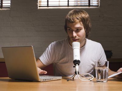 Young man with laptop and microphone