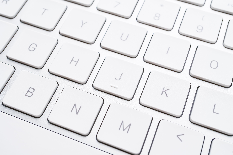 Full frame shot of white laptop keyboard