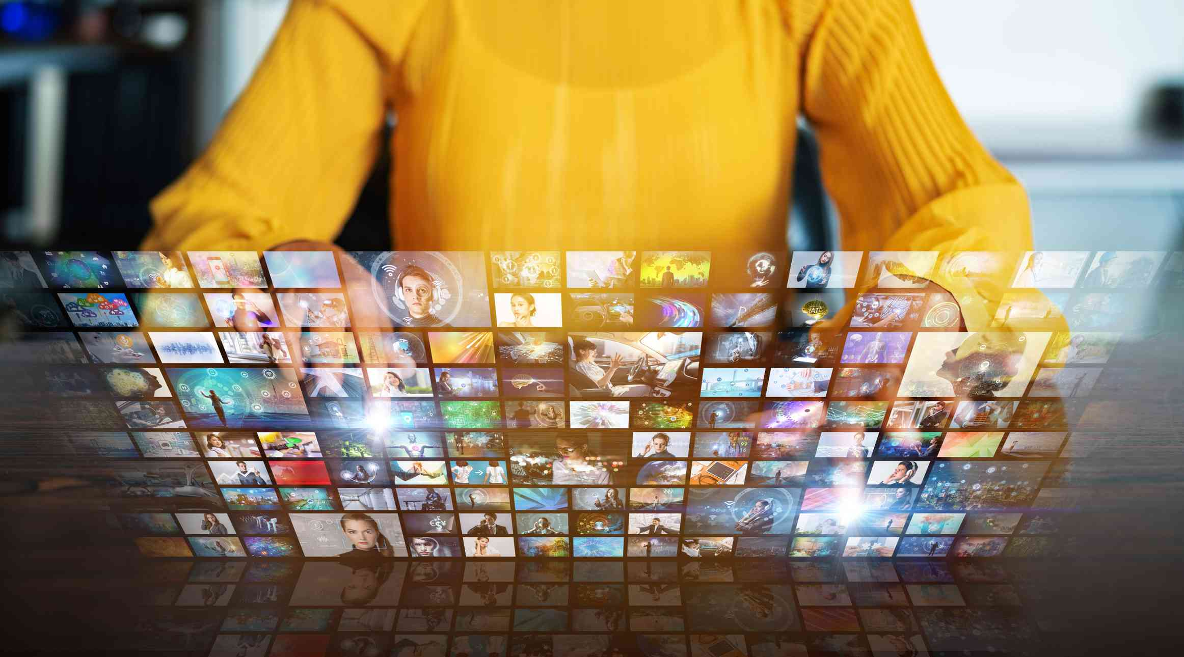 A concept image of someone browsing TV channels on a virtual screen.