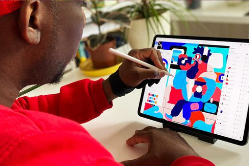 Adobe Illustrator being used on an iPad with an Apple Pencil