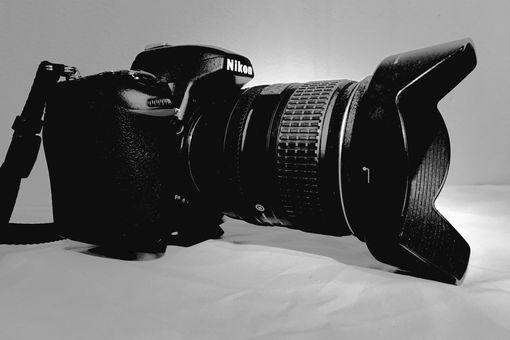 A Nikon DSLR camera with a lens hood.