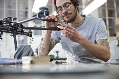 Man assembling drone in workshop