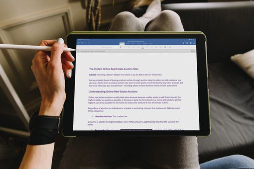 Someone working in Microsoft Word on an iPad.