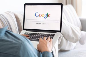 Google search engine appearing on a laptop.