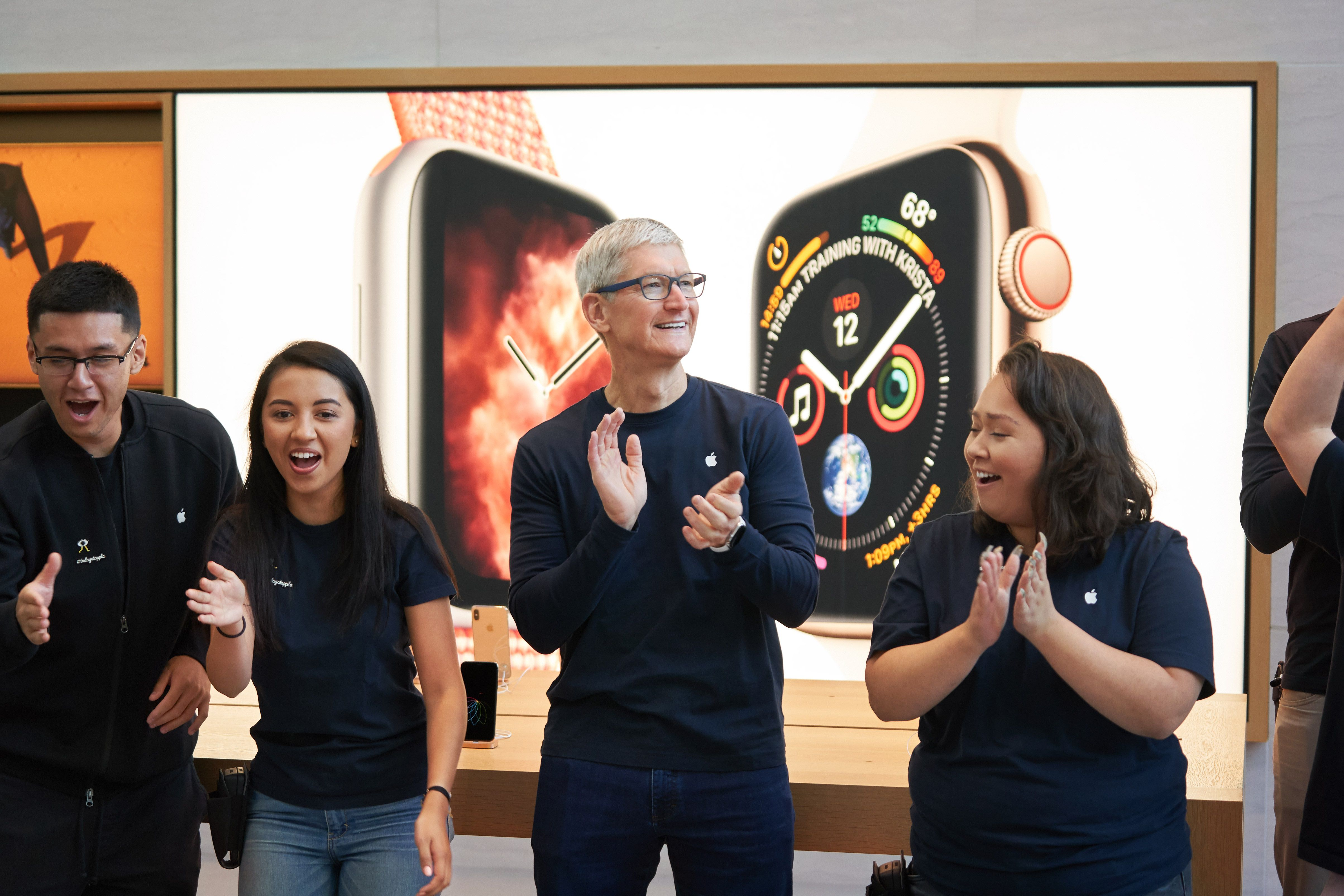 Tim Cook in an Apple Store with Apple employees