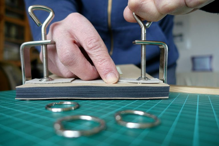 Cropped Image Of Craftsperson Working Book Binding At Workshop