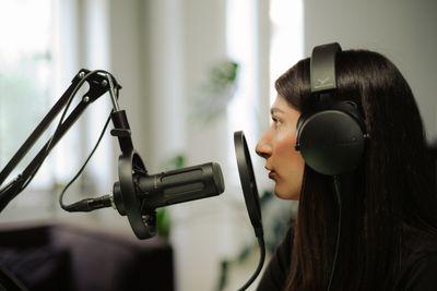 Some using the Beyerdynamic DT 700 Pro X headphones while recording audio.