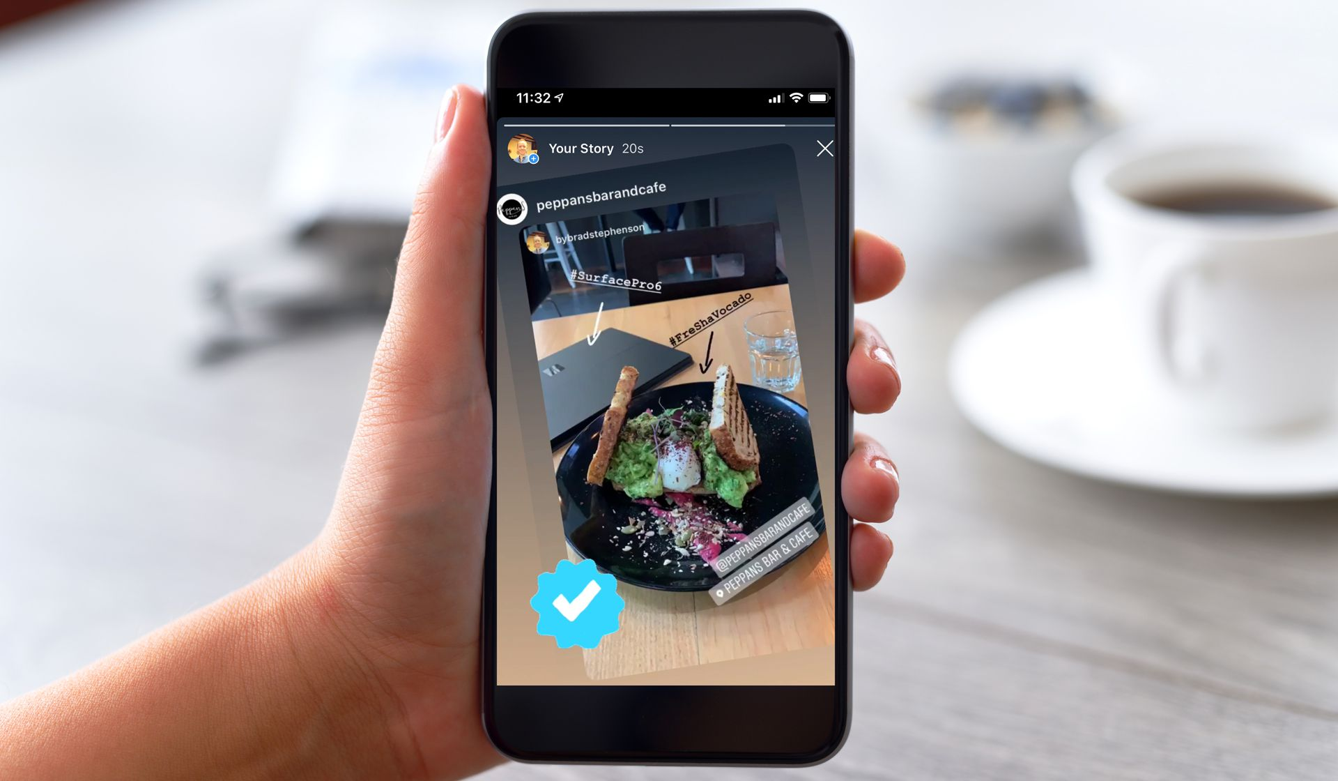 A woman resharing an Instagram Story with the iPhone Instagram app in a cafe.