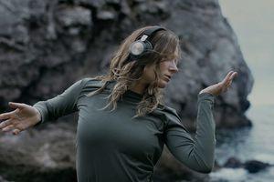Woman wearing Bang & Olufsen headphones