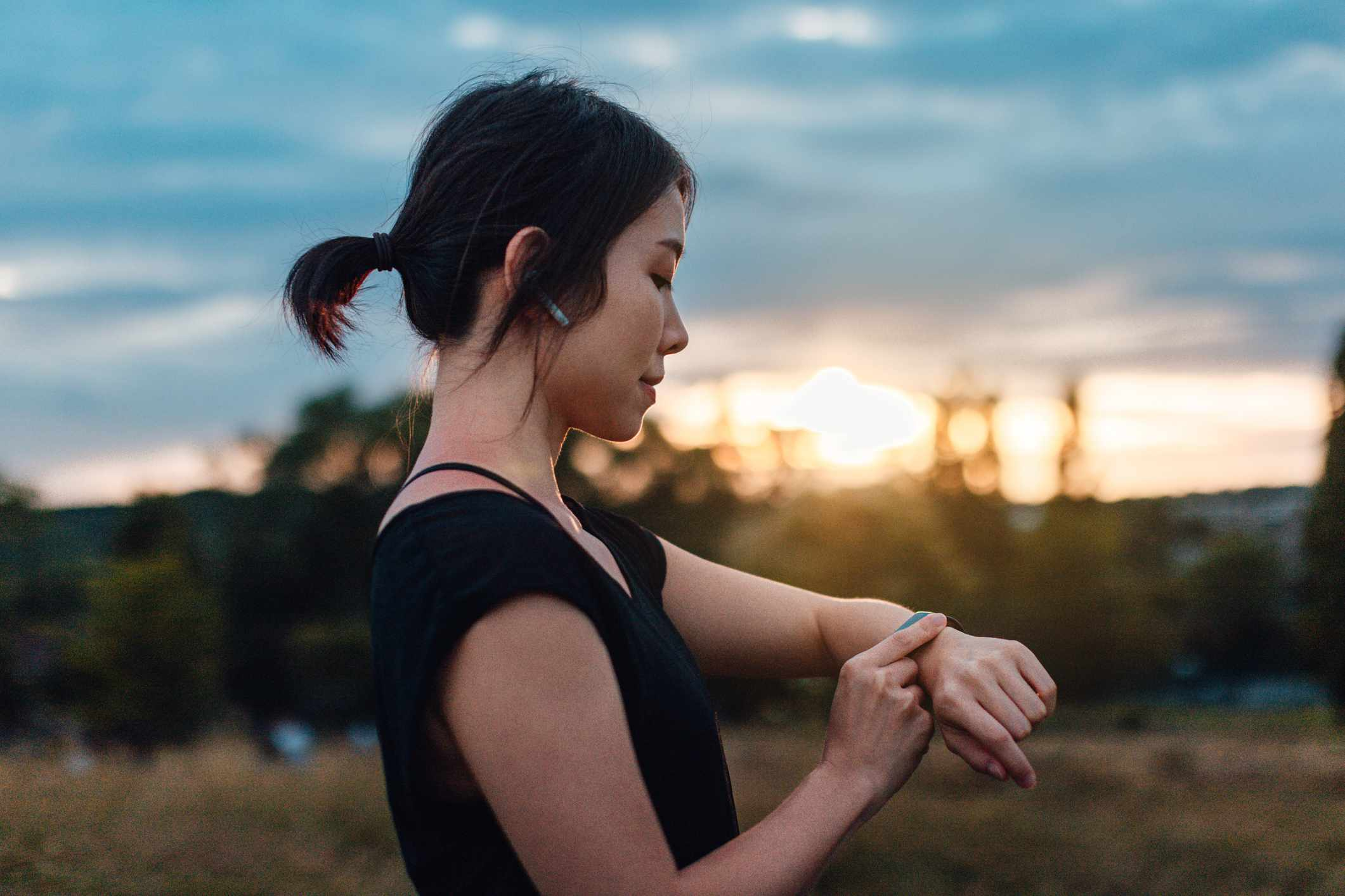 Woman listening to smartwatch