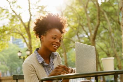 Woman using laptop at park