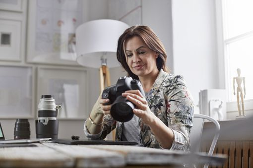Woman with camera in office