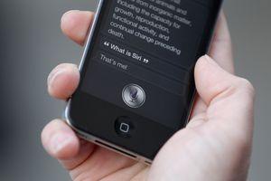 Person using Siri on phone