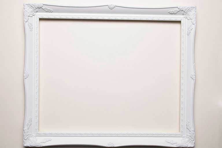 Empty white picture frame on a white background