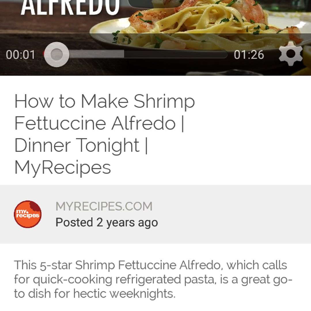 A screenshot of the Yummly app on an Android phone. This screenshot shows one of Yummly's recipe video guides for Shrimp Fettuccine Alfredo. The video is at the top third of the screenshot and the bottom two-thirds of the screenshot is a quick recipe description.