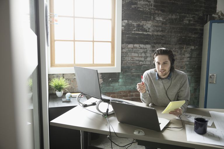 Image of a man sitting at a computer during a conference call