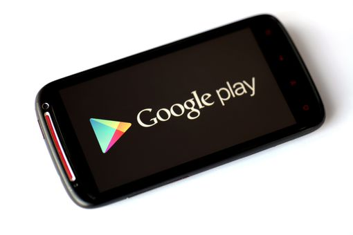 The Google Play logo displayed on a black smartphone.