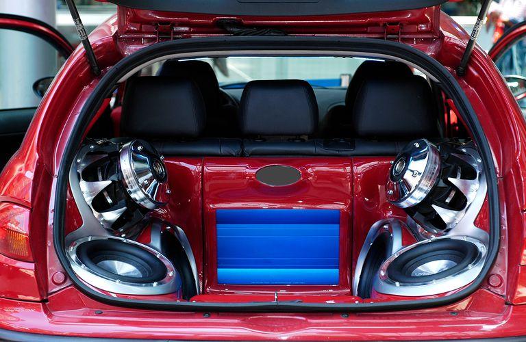 Hi-fi music big loudspeakers installed in a car's trunk.