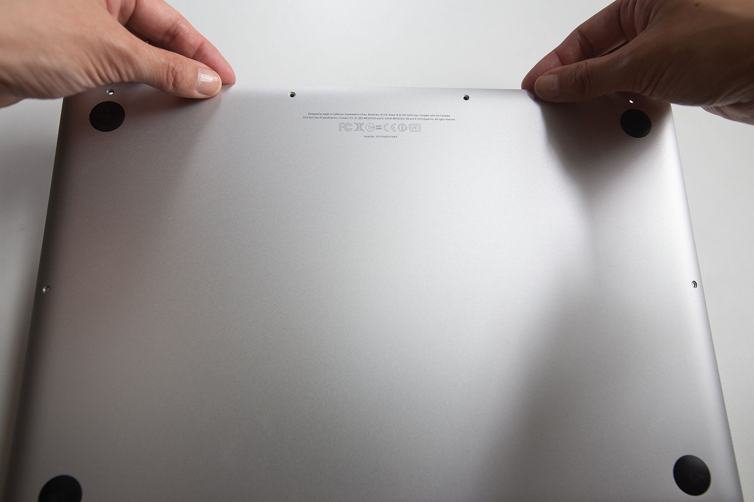 Removing the bottom lid of a MacBook Pro