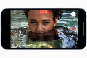 Apple iPhone 13 Pro in video mode recoding a person in water.