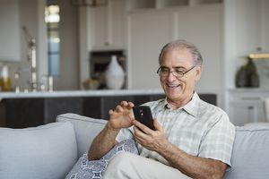 Senior citizen using smart phone
