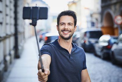 Man taking selfie with selfie stick