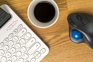A trackball mouse with a tablet and keyboard