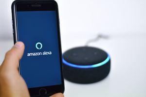 Someone using Amazon Alexa with a smart speaker.