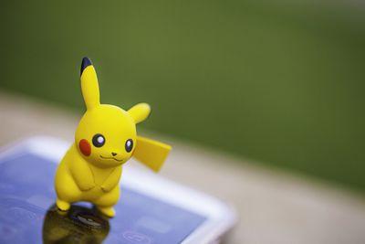 Pikachu figurine and smartphone