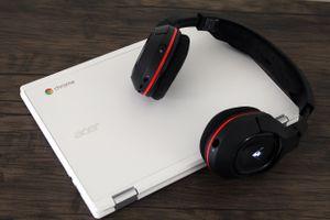 A Chromebook with a Bluetooth headset.