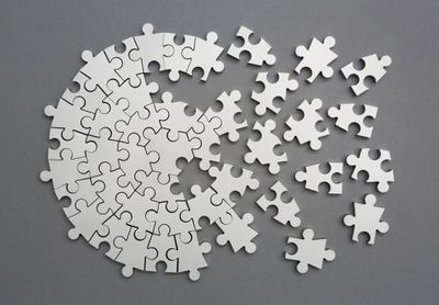 Picture of a half assembled silver metal puzzle