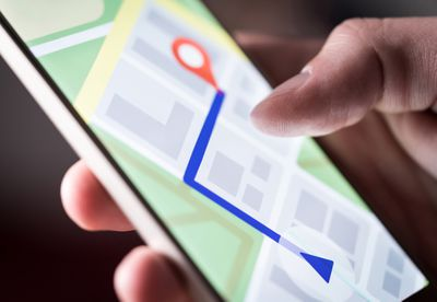 Closeup of a digital map on a smartphone that someone is holding.