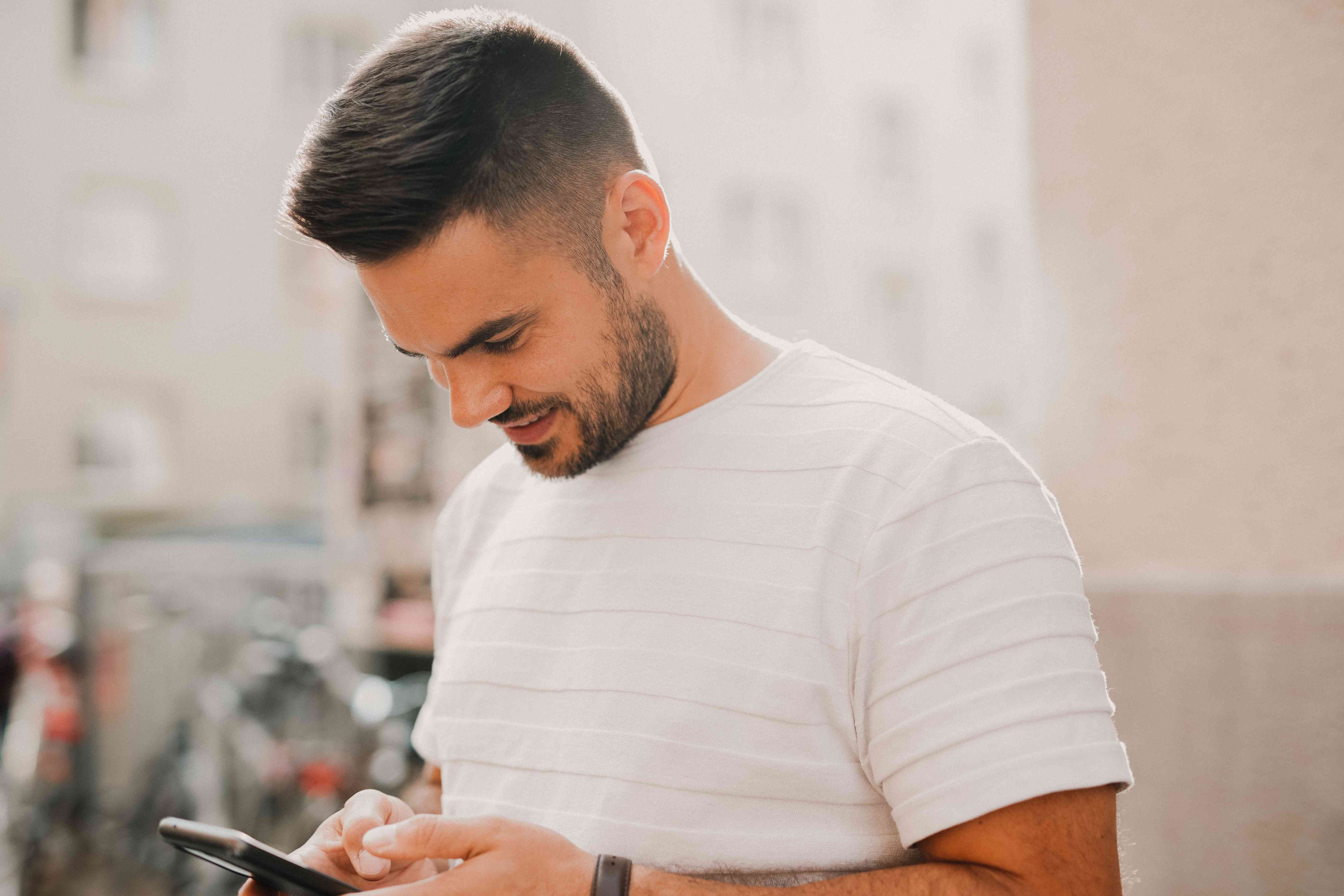 A person sending a message on a smartphone.