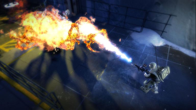 A marine fires a flame thower at one of the many enemies in Alien Swarm