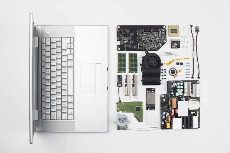 Macbook Pro laptop disassembled with internal components displayed