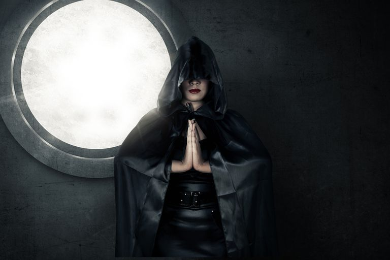 Woman wearing dark cloak
