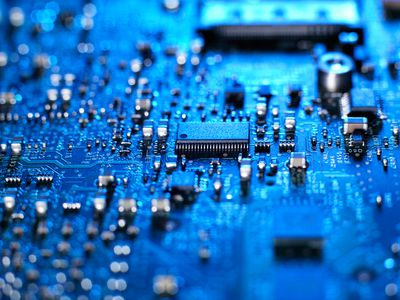 Inside of a laptop computer showing chips, circuit boards and components