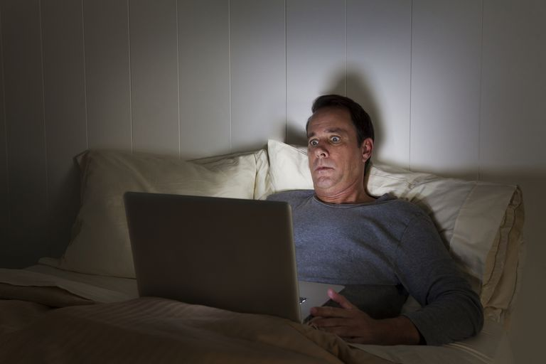 Scared man looking at computer