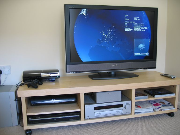 A typical home theater setup with connected TV, stereo receiver, speaker, gaming console, and components.